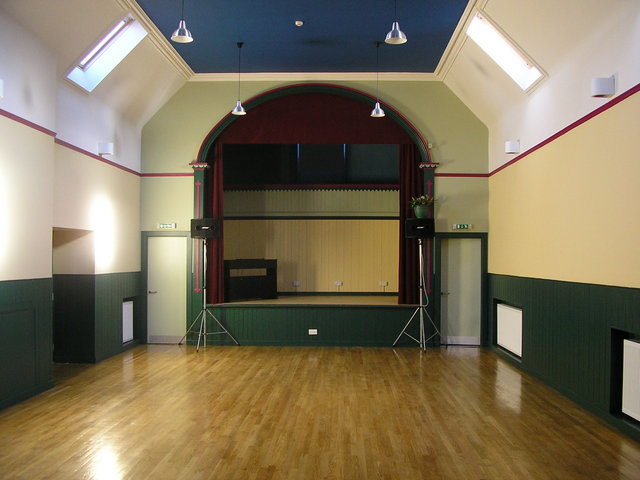 The newly refurbished main hall, featuring the original stage with gallery.